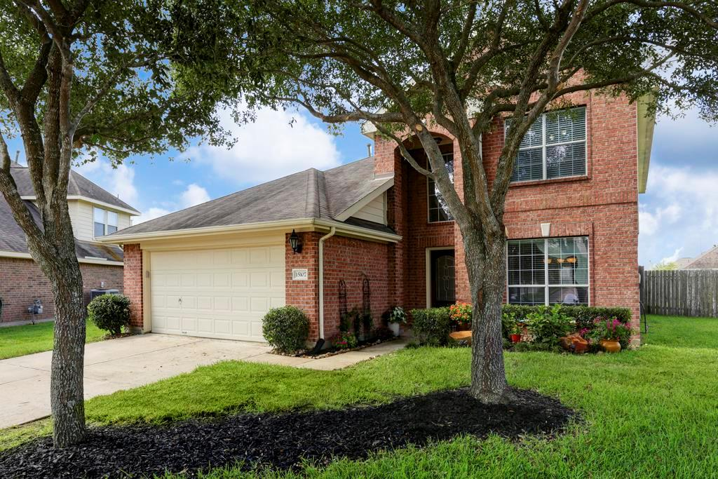 Photo of home for sale at 15107 Petal Rose Court, Cypress TX