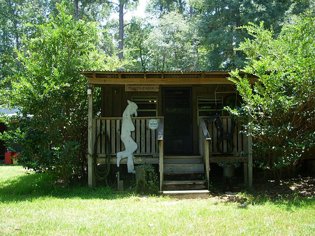 Photo of home for sale at 210 Pine Road, Coldspring TX