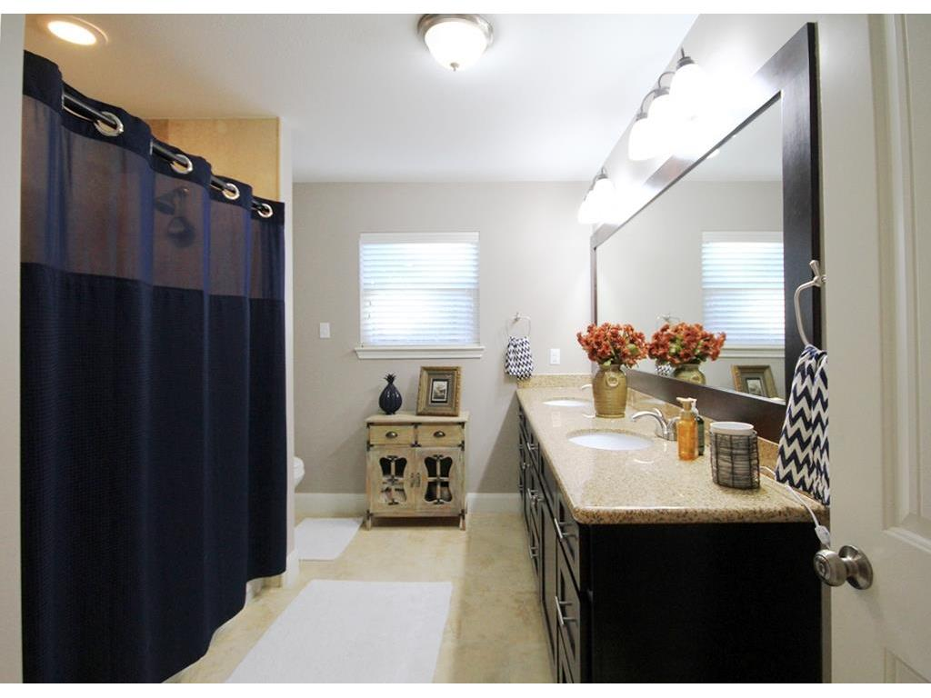 Large secondary bathroom offers lots of counter space and double vanities.