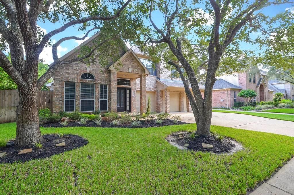 Photo of home for sale at 931 Burchton Drive, Sugar Land TX