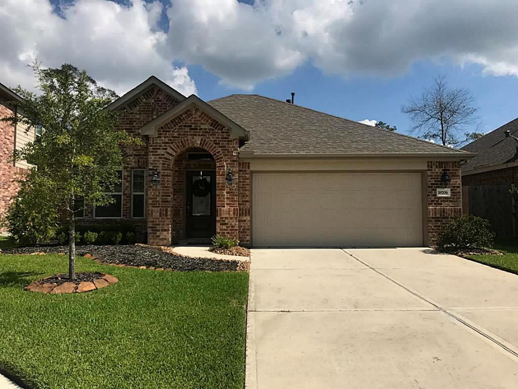 Photo of home for sale at 18706 Langley Pond Lane, New Caney TX