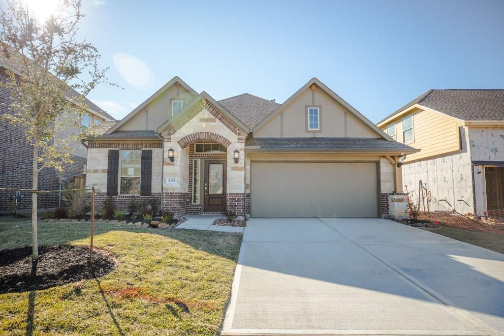Photo of home for sale at 2365 Old Stone Drive, Conroe TX