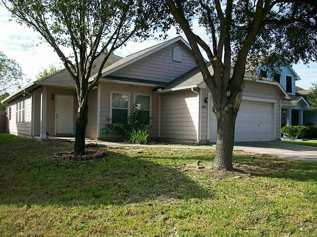 Photo of home for sale at 12626 Roxdale Ridge N, Houston TX