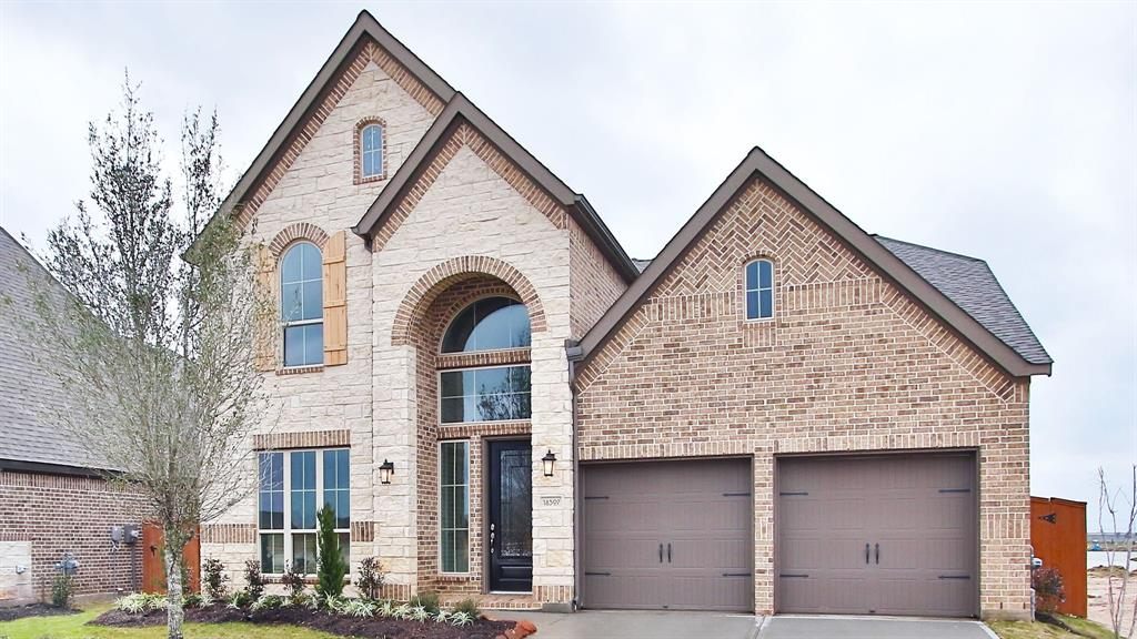 Photo of home for sale at 18307 Newmachar Way, Richmond TX