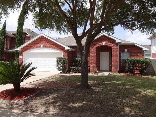 Photo of home for sale at 21706 Oak Bridge Park Lane, Katy TX