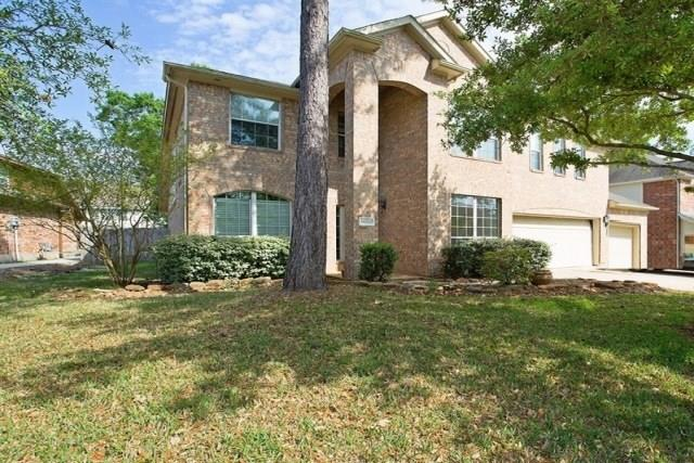 Photo of home for sale at 18522 Timber Shores Lane, Humble TX