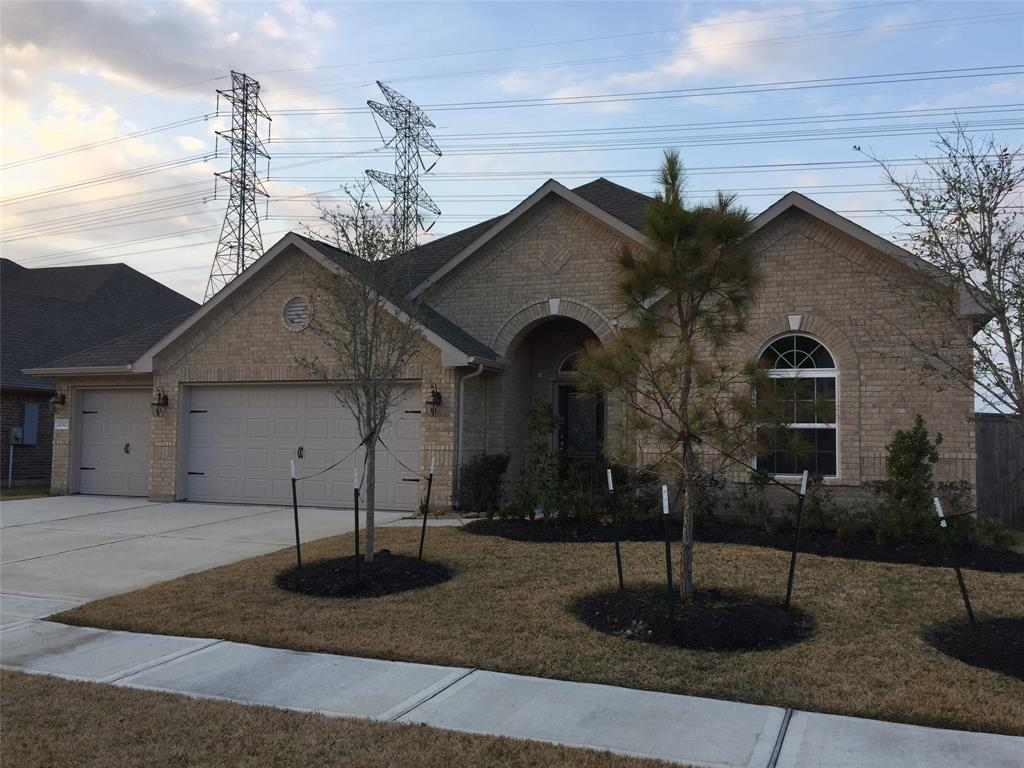 Photo of home for sale at 20302 Fossil Valley Lane, Cypress TX