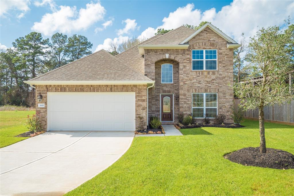Photo of home for sale at 26010 Hastings Ridge, Kingwood TX