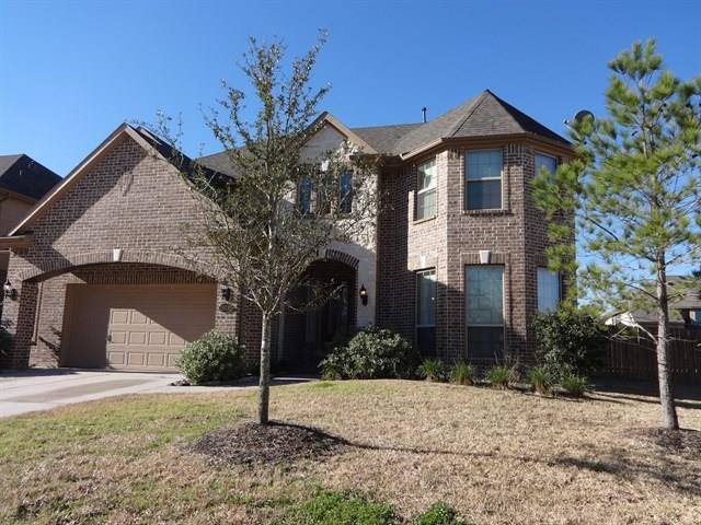 Photo of home for sale at 28035 Hallimore Drive, Spring TX